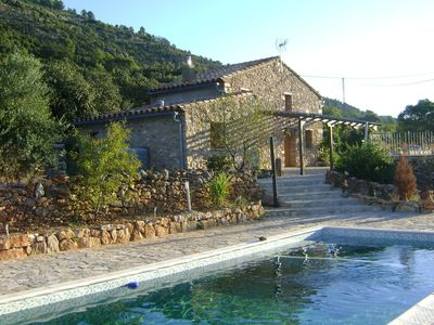 Photo for A beautifully restored farmhouse with a private pool in the mountains