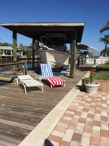 Photo for PROFESSIONALLY DECORATED WATERFRONT HOME WITH ENCLOSED POOL AND A GREAT LOCATION