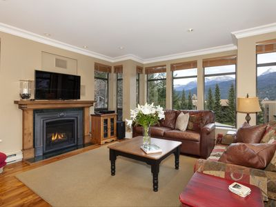 Photo for Bright corner unit with mountain views & hot tub!