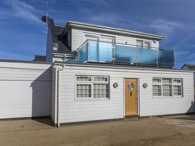 Photo for Recently renovated house, moments from one of England's finest sandy beaches!