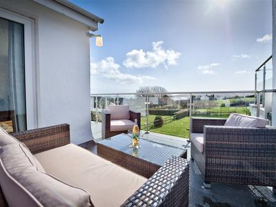 Photo for Fabulous sea views can be enjoyed from the impressive glass balcony of this attractive modern house,