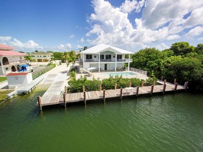 Photo for Stunning New Luxury KCB Canal Home with pool and 4 Master Suites