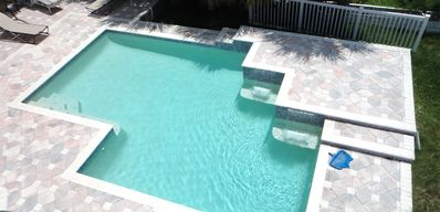 Pool Area - Vacation rental offered by Beach Time Rentals