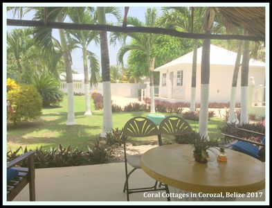Gated, exclusive tropical gardens with palapa, loungers, chairs all with cushion