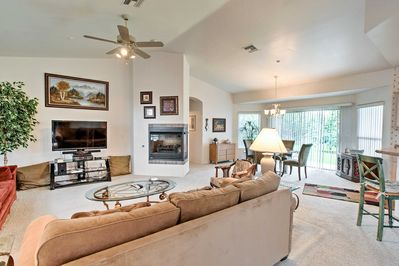 Relax in the living room with the large satellite TV and DVD player.