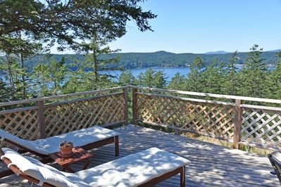 The large waterside deck is perfect for lounging and reading a good book while overlooking an excellent water view.