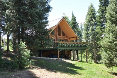 Our cabin on 2 acres of wooded forest bordering Steamboat Lake State Park.