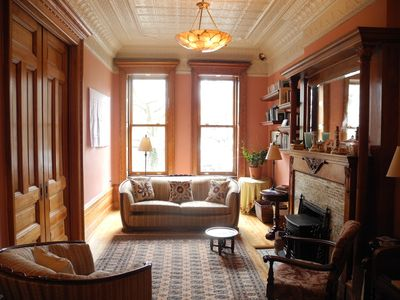 The elegant front Parlor, with original features, overlooks the park