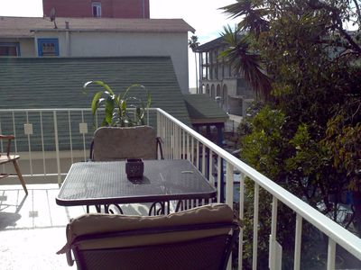 attached patio with dining table and charis