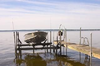 one of two boatlifts. 12 foot row boat included with oars.