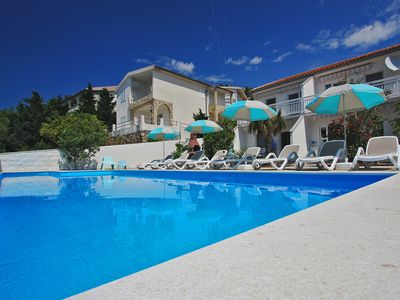 Photo for Apartment Anita with heated pool - directly on the beach or sea