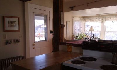 kitchen work area, separated from sunroom by high bar/counter area.