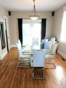 The dining room has beautiful hardwood flooring and has patio door access to the rear deck and yard.