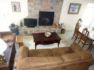 Living room with a real fireplace and original art by Art Fowl