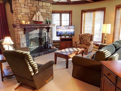 Turret-style living room with fireplace and views to the golf course
