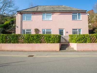 Photo for Ruby Cottage sits in an enviable location overlooking popular Saundersfoot's beautiful sandy beach.
