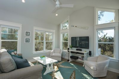 Beautiful and spacious living room with expansive views of Davis Canal