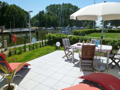 Photo for Captain residence in a prime position in the water, the beautiful harbor Stagnieß, Terrace