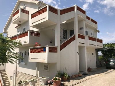 Photo for Two bedroom apartment with balcony and sea view Banjol, Rab (A-15679-b)