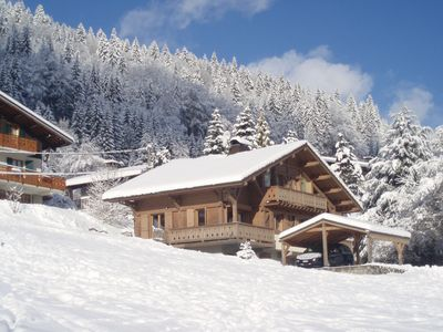 Photo for Beautiful sunny chalet with hot tub,  central Morzine, fantastic ski-in location