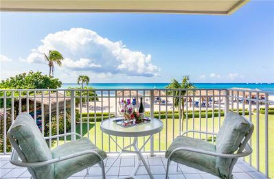 Photo for Beautiful ocean views from this 3-bedroom condo with lively decor located on Seven Mile Beach