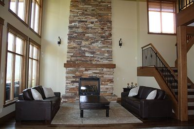 The living room - complete with a stunning floor to ceiling fireplace