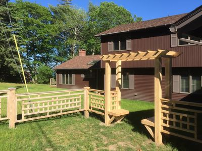 Wooden fence surrounding the front property!