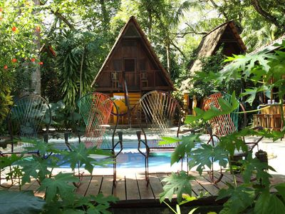 Private cabinas surrounding the pool include private baths, kitchens, patios.