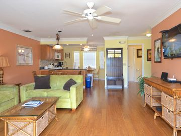 Colorful condo w/ deck, balcony & shared pool - near downtown & beaches, dogs ok