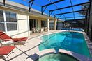 The covered lanai provides pool side shade from the Florida sun.