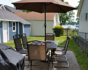 Outdoor patio set to enjoy those freshly grilled meals and views of Spring Lake.