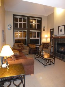 Lounge with vaulted ceiling. Lots of comfy seating and enclosed gas fire