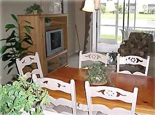 Dining & family room with walk-out to lanai and lake