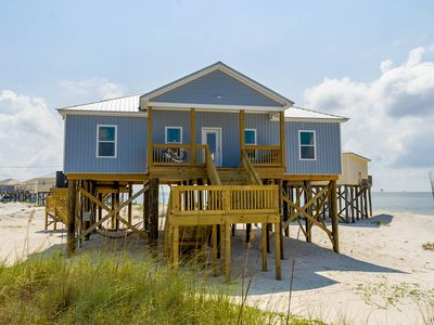 Photo for NEW LISTING! Beachside home with covered deck, full modern kitchen, & free WiFi
