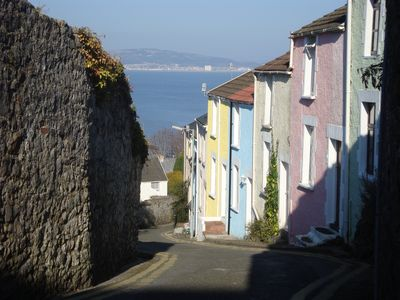 It's the blue one with the black down-pipe! 100m from the sea, great views. Yay!