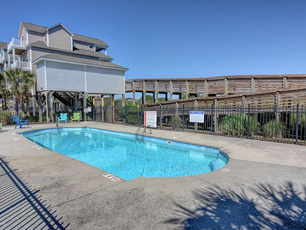 Waterfront home community pool elevator vrbo for House plans with elevators waterfront