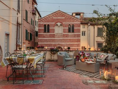 Photo for A Homey Quiet Idyllic Apartment with Terrace Inside the Walls of Lucca