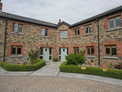 Photo for Two bedroom cottage in a landscaped courtyard in the heart of Ireland's Ancient East Region.