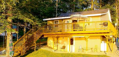 Spacious lakefront deck Enjoy the view of pleasant pond and the great sunsets.