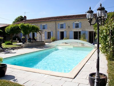 Photo for Vacation home La Cagouille  in Saint Jean d'Angely, Poitou - Charentes - 9 persons, 4 bedrooms