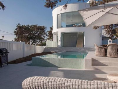 Photo for Stunning beachside brand new lounge villa with private pool and rooftop pool