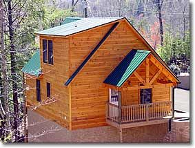 Photo for All log cabin with a  winter view, Hot Tub, Game Room, Jacuzzi, FP and Wi-Fi.