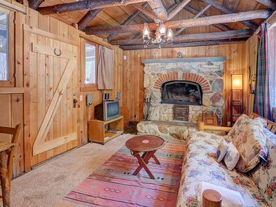 Photo for Rustic, warm cabin w/outdoor deck, woodland views - close to town!