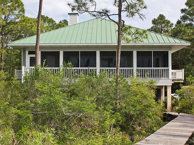 Photo for PEACE AND QUIET SURROUNDS this remarkable home, nestled in the Plantation, overlooking the bay.