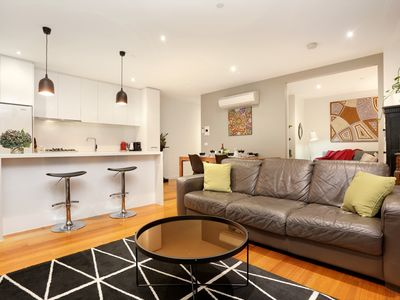 Photo for Two-bedroom sub-penthouse plus sofa bed near trains, trams, shops, pool, gym etc