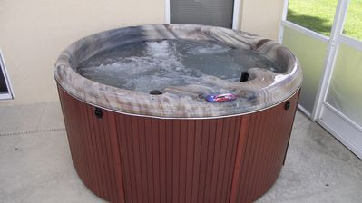 New 5 person Hot Tub to soak away the aches of the parks