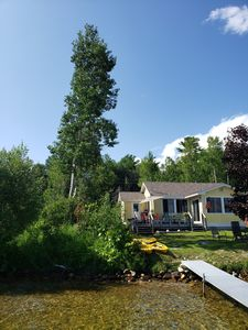 Photo for Book now for fall color! Lakefront cottage just steps from Mullett Lake w/kayaks