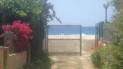 The property features private beach lane access to Solanas beach.