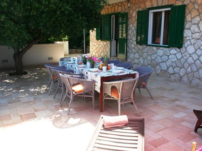 Photo for Spacious luxury villa just 50m from the beach, with large dining terrace