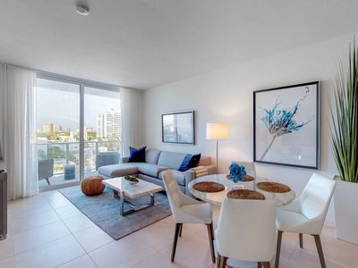 Photo for Airy condo w/ shared pool & ocean views - walk to the beach!